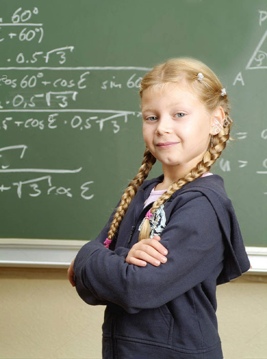 Confident Girl standing in front of chalk board.